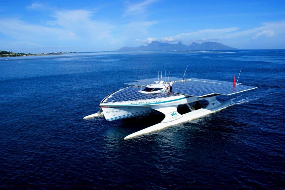 The TURANOR PlanetSolar cruises past Tahiti