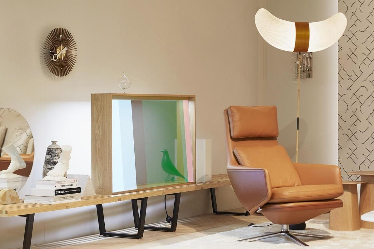 The transparent OLED display concept from Panasonic and Vitra has been designed to seamlessly blend into the living room