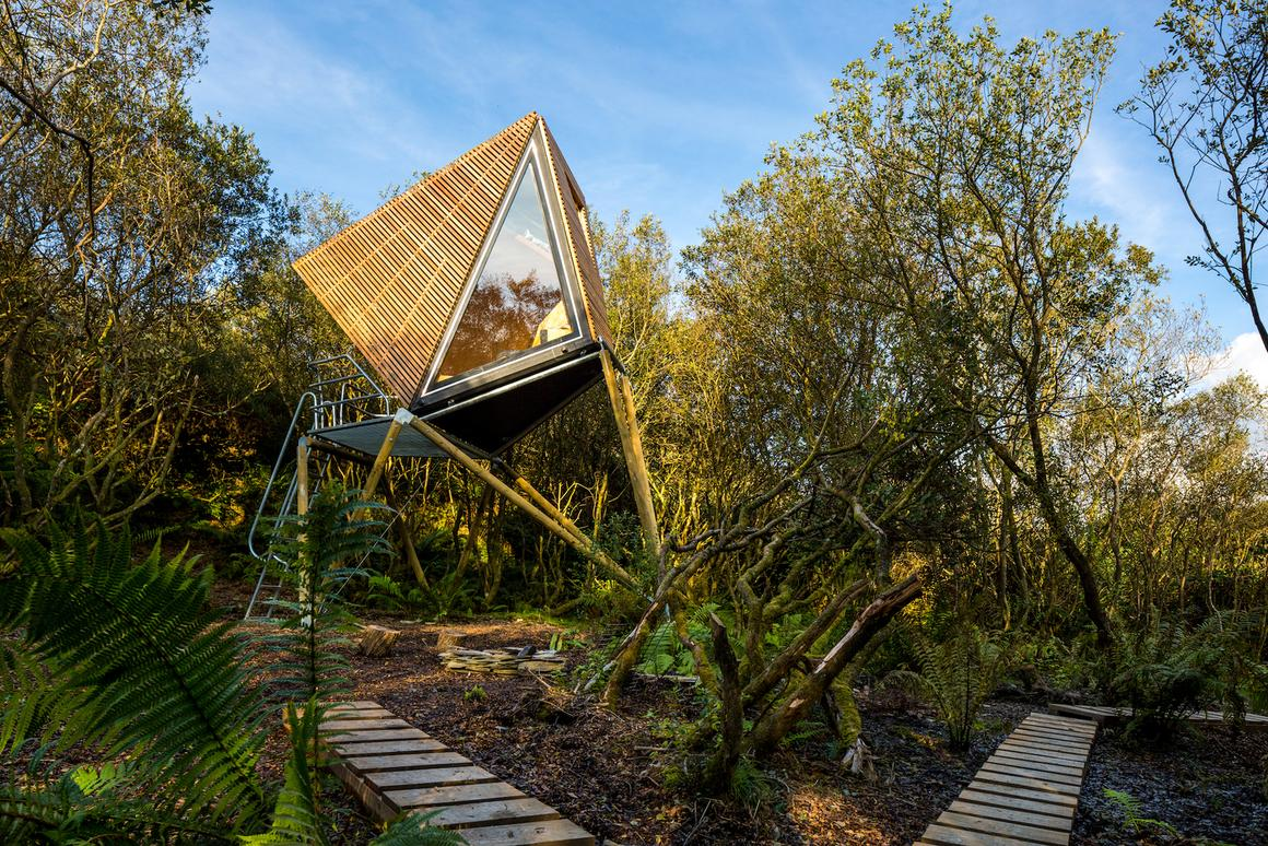 The tiny cabins are built with a geometric timber shell, large triangular glass window and small steel balcony