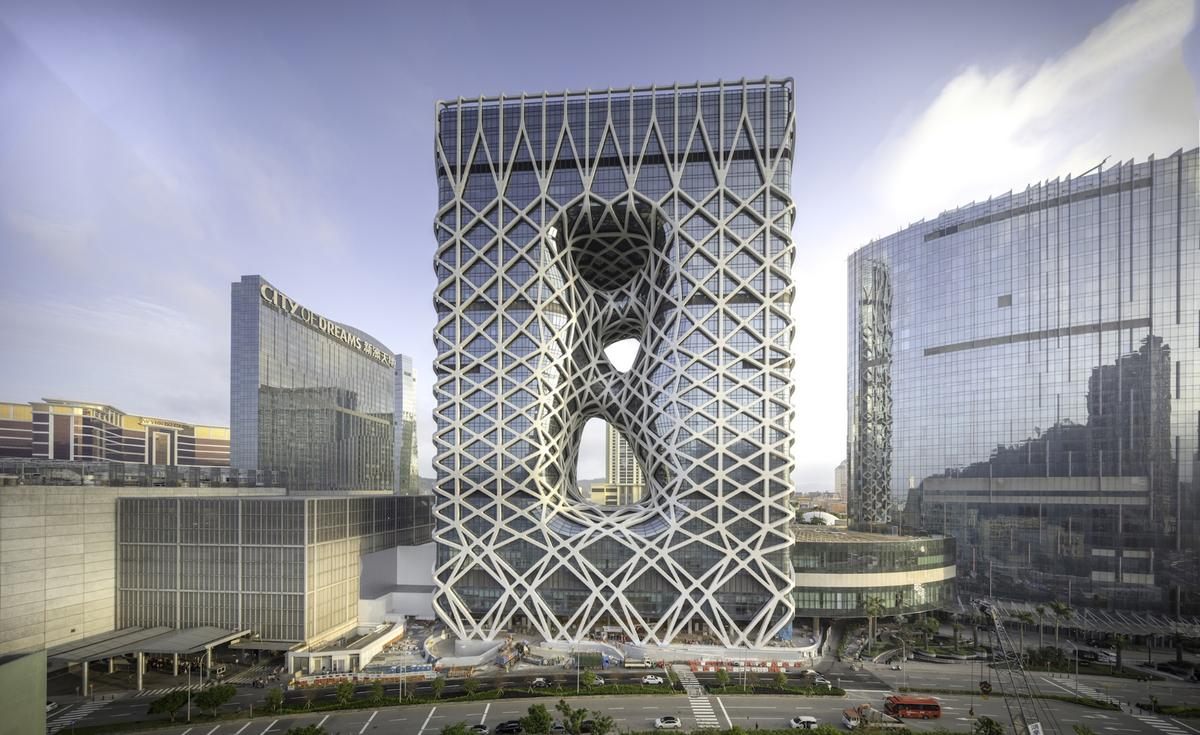 Morpheus Hotel is wrapped in asteel and aluminumexoskeleton that provides structural support