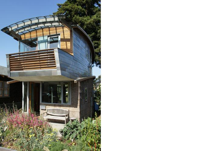 The upper outside walls of the McGee house are made from over 100 salvaged car roofs