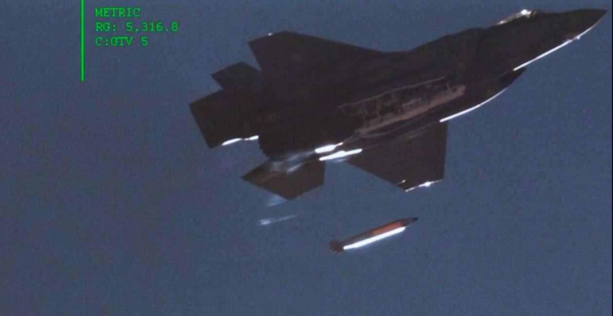 An F-35A Lightning II fighter dropping a B61-12 mock nuclear bomb