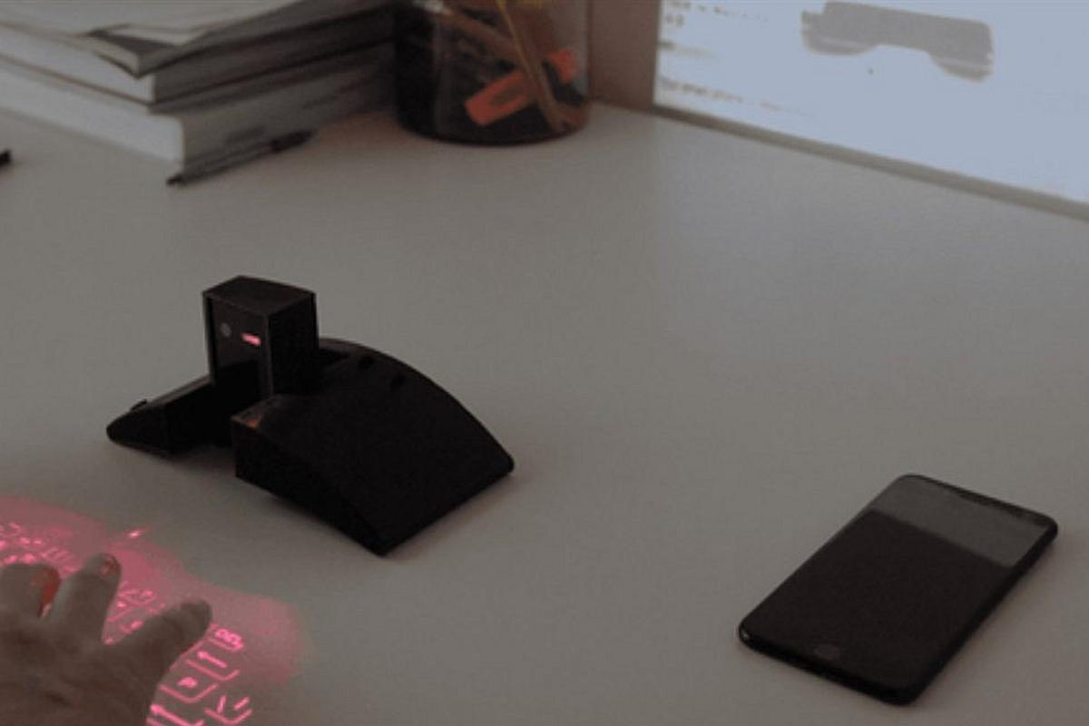The Masterkey 4.0 projects a laser keyboard on the desk and a display on the wall