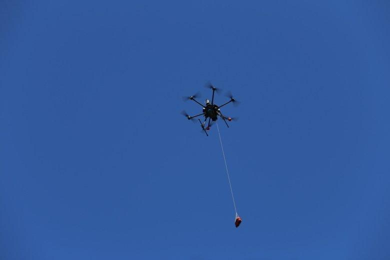 A drone delivers a defibrillator as part of real-world testing