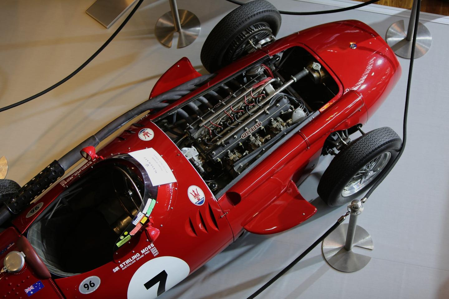 "A Maserati 250F, with some of its history evident from the war paint. In a time of gentlemanly behavior, Juan Manuel Fangio was contracted to drive for the new Mercedes-Benz racing team in 1954 but as the cars weren't ready, the company allowed him to drive the car of his choice. He chose a Maserati 250F. When the all-conquering Silver Arrows arrived, he already led the title race with two wins from two starts. Sir Stirling considered it ""the finest front-engined Formula One car you could ever drive."""