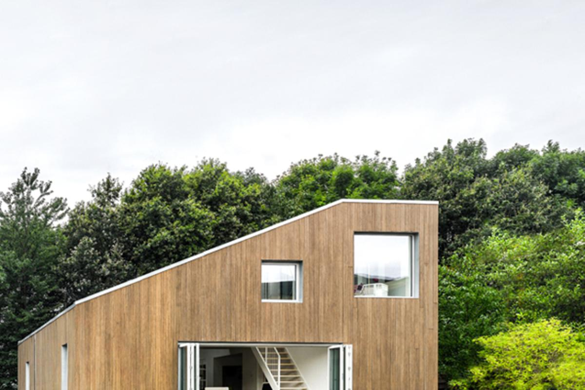 WFH House by Danish architectural studio Arcgency, incorporates the use of recycled shipping containers into a modular building system.