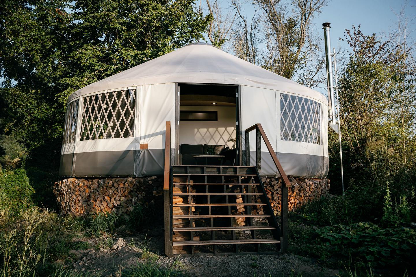 Utilizing a traditional yurt structure, the home measures just over 30 ft (9.14 m) in diameter