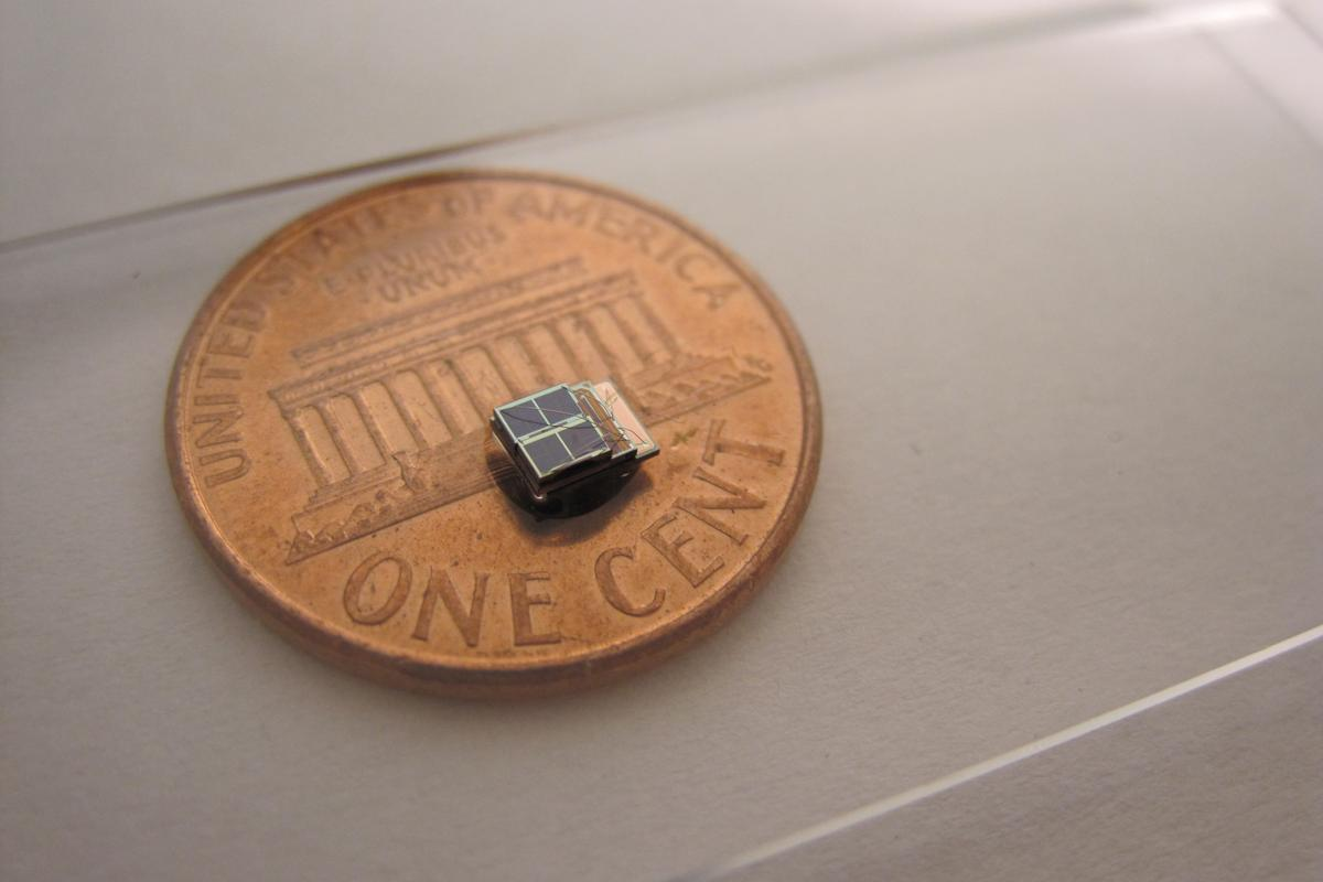 A low-power sensor system developed at the University of Michigan is 1,000 times smaller than comparable commercial counterparts. It could enable new biomedical implants. Photo (Daeyeon Kim)