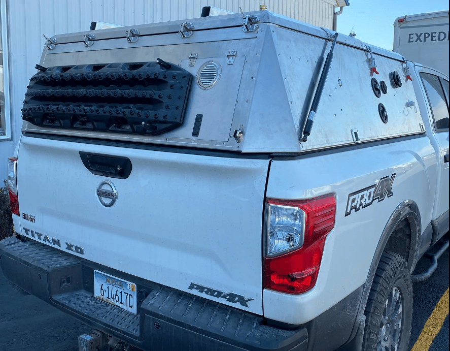 Many pickup toppers and campers sit well higher than the truck cab, but Skinny Guy has designed its camper to sit at roughly cab level in box form, no alcove or extension over top the driver area