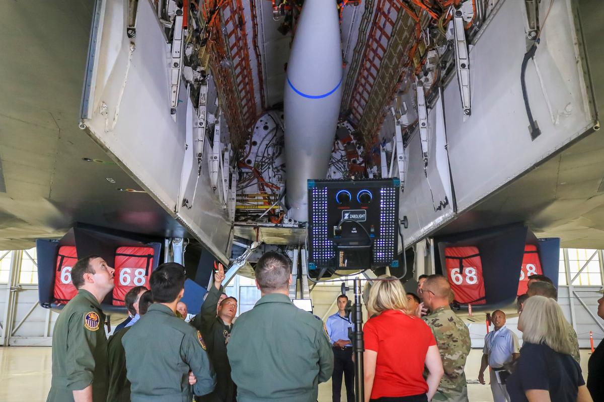 Lt. Col. Dominic Ross, B-1B program element monitor, Air Force Global Strike Command, explains a bulkhead modification to the B-1B bomber that allowed it to carry a notional hypersonic missile mock-up attached to a B-52H Conventional Rotary Launcher