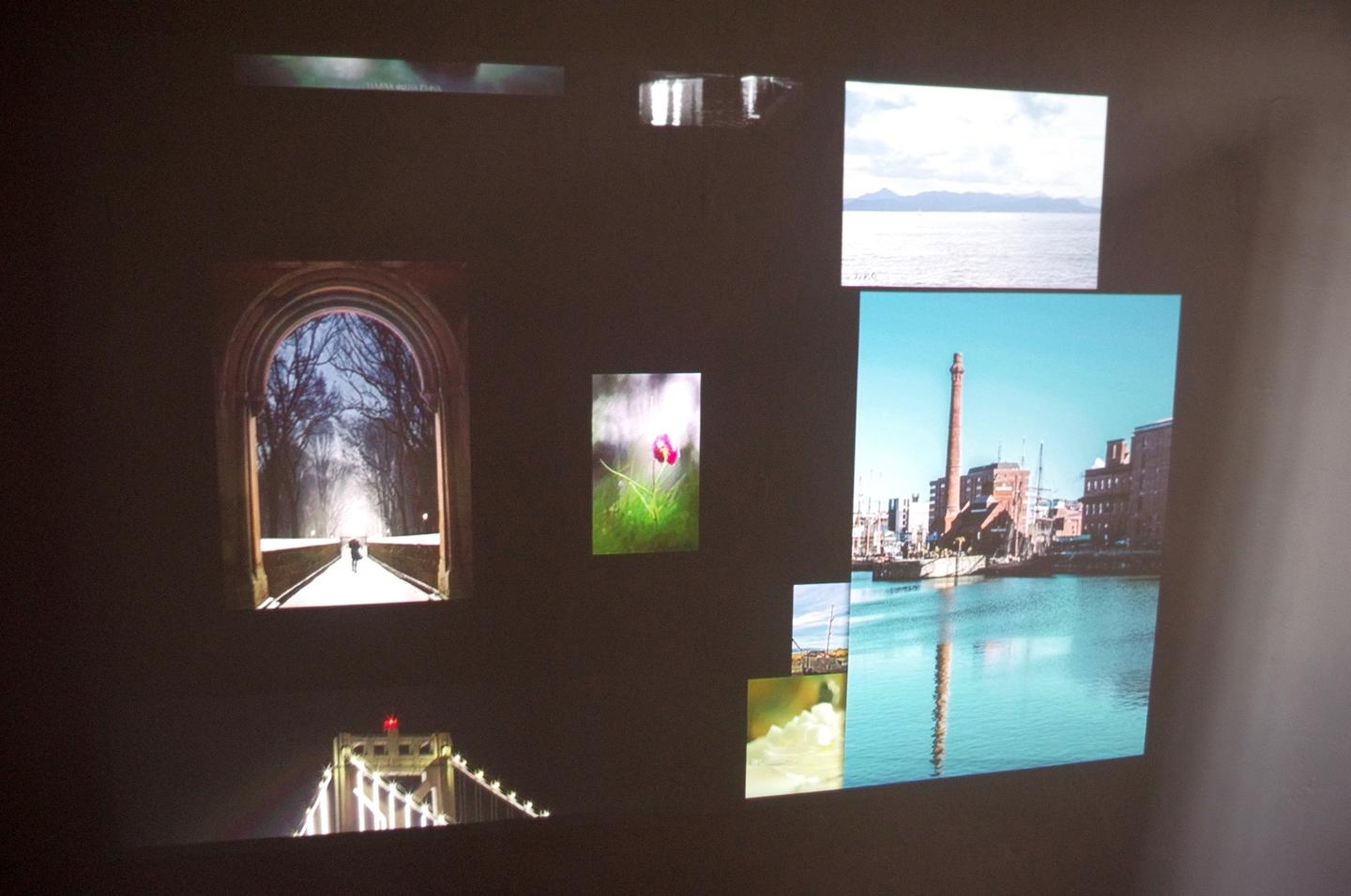 The projector works great at displaying videos and photos, like these from the Apple TV screensaver