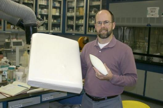 Sandia materials researcher LeRoy Whinnery poses with two TufFoam samples. Originally created for the National Nuclear Security Administration (NNSA) to protect sensitive electronic and mechanical structures from harsh environments, the foam's properties
