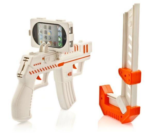 The appBlaster is an iPhone accessory that allows you to shoot at virtual aliens in your real-life surroundings, via the Alien Attack augmented reality app (Photo: RED5)