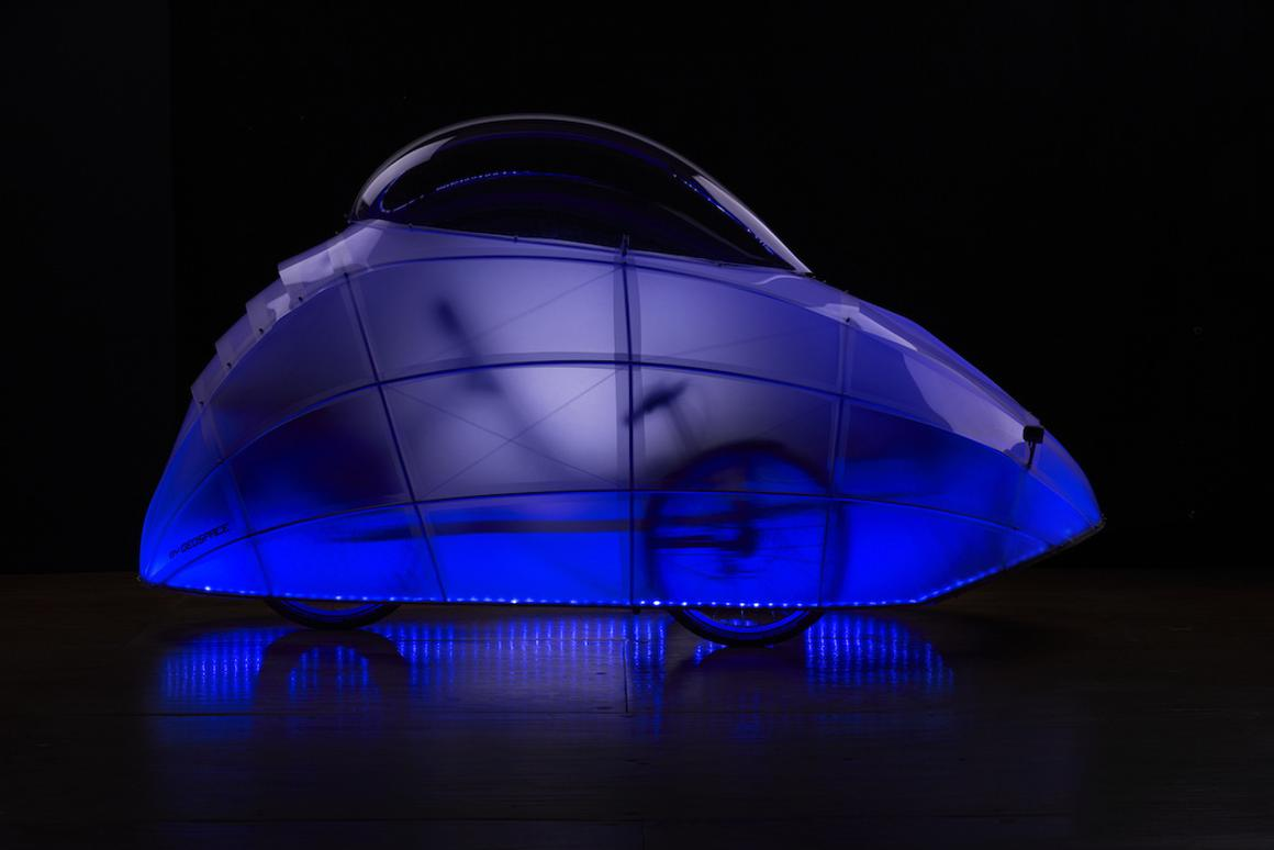 The FireFly recumbent tricycle outfitted with an LED-lit dome