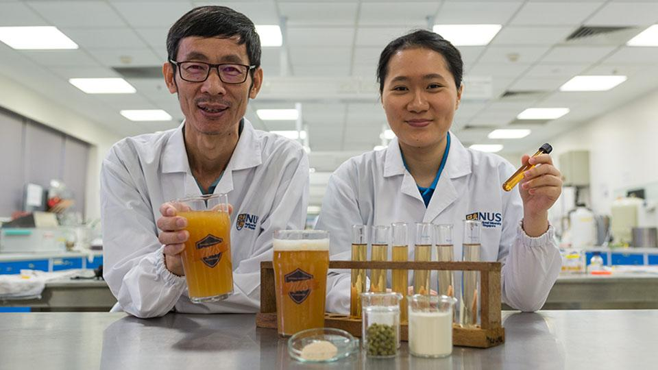 Associate Professor Liu Shao Quan (left) and Chan Mei Zhi Alcine (right), with their bacteria-filled beer