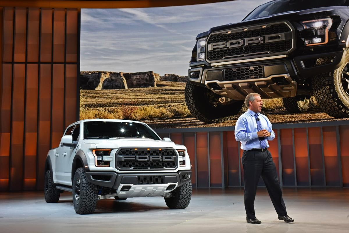 Joe Hinrichs, Ford president of The Americas, introduces the F-150 Raptor SuperCrew at the North American International Auto Show