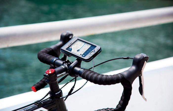 The Bycle mount keepsphones flat for easy access to the screen, and uses a prism to redirect the camera to the front of the bike for POV video