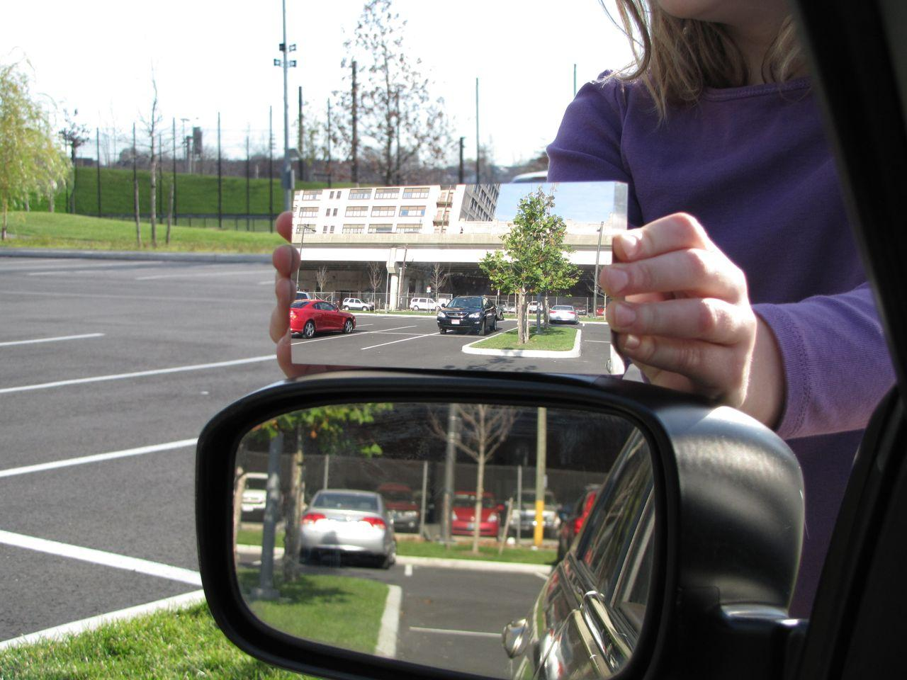 Dr. Hicks' mirror (top) as compared to a regular flat driver's side mirror