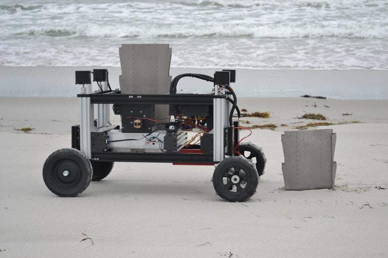 The Romu robot, seen here inserting sheet piles in the sand