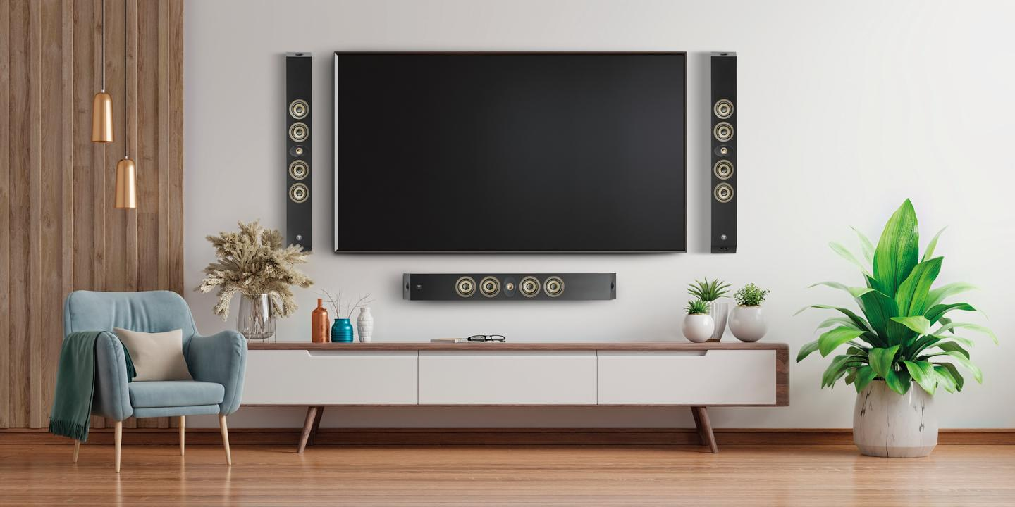 """The On Wall 300 series speakers surround the living-room television to provide """"immersive listening in both home cinema and music setups"""""""