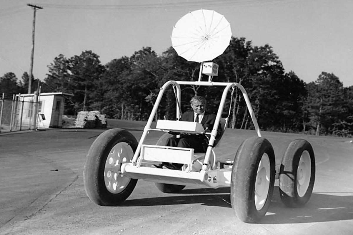 The prototype moon buggy is shown here being piloted by Wehrner von Braun, the vehicle is considered an important part of space history