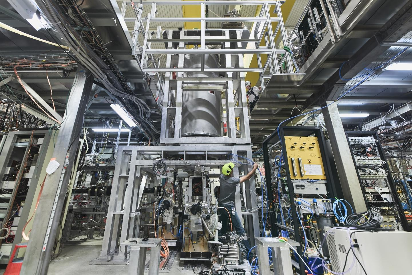 The ALPHA-g experiment being set up at CERN, which will drop antimatter to see how gravity affects it