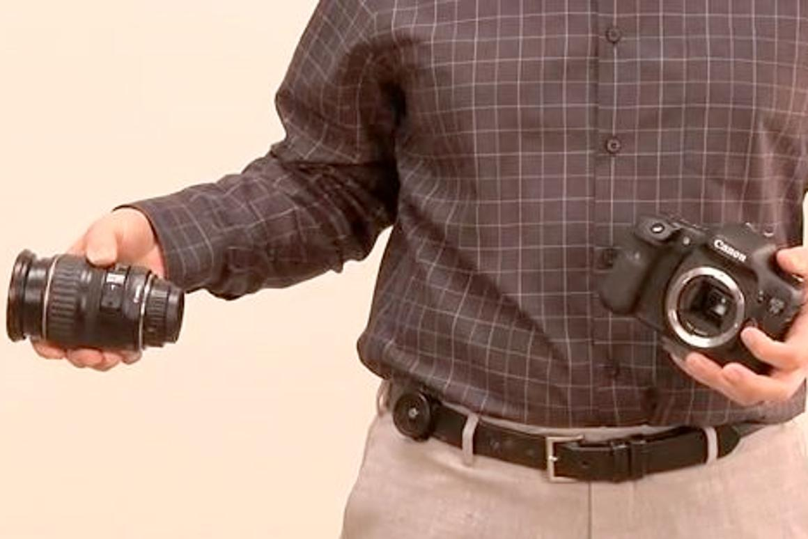 The Backer Capper (seen here mounted on a belt) is a product that's designed to make it easier for photographers to change lenses when they can't put their camera down