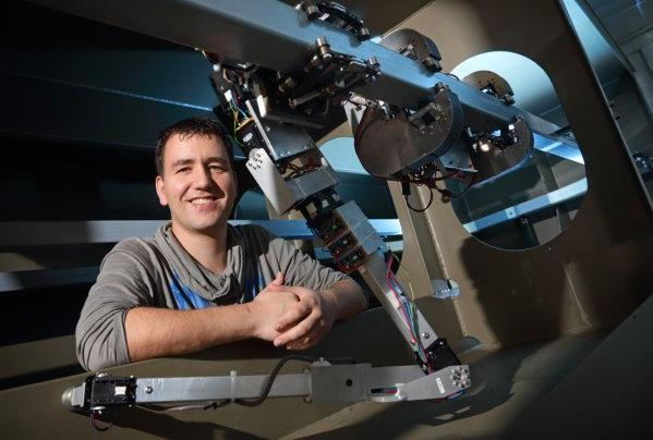 University of Twente researcher Dian Borgerink, with a manipulator arm that he developed for the RoboShip robot