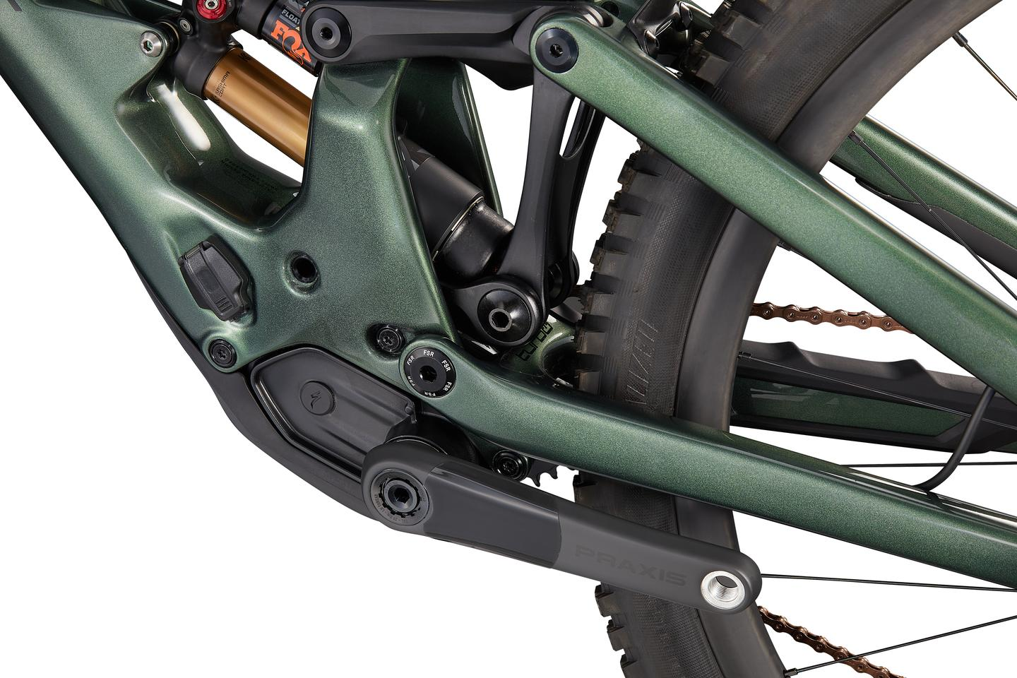 The rear suspension setup includes a six bar linkage system