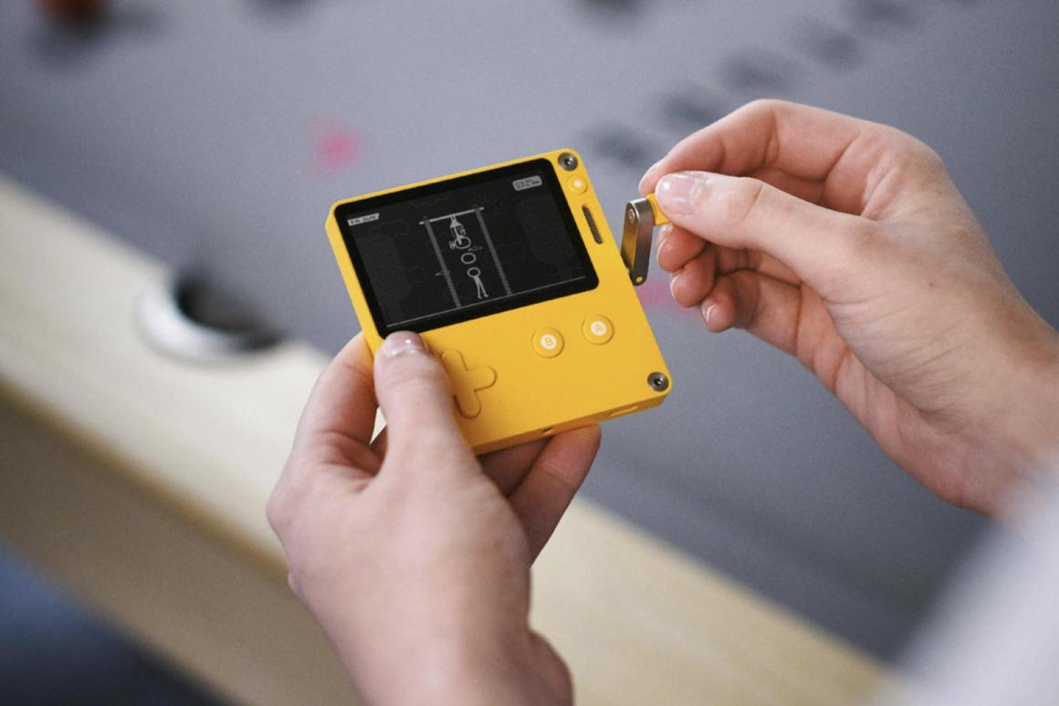 The crank-handle of the Playdate handheld games console in action