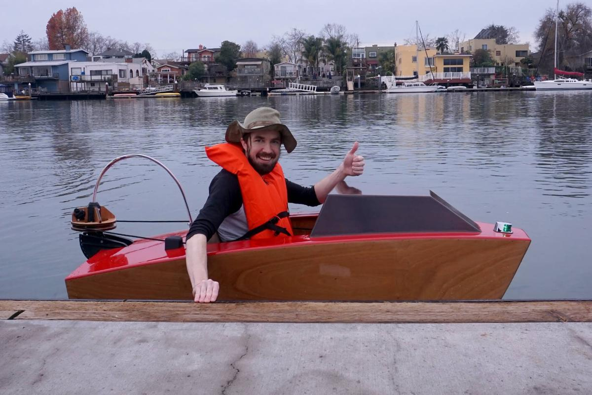 Bay Area maker Josh Tulberg pushes off to motor along at up to 4 knots in his electric Mini Boat