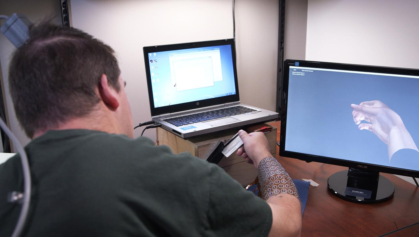 After hundreds of therapy sessions Burkhart can now use the NeuroLife system to perform a number of functional tasks