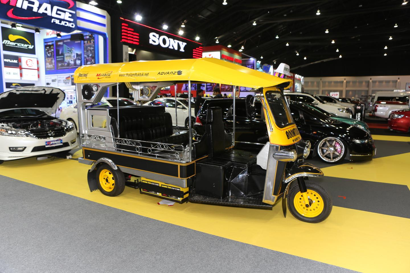 A pimped out tuk-tuk with a massive sound system at the Thai Motor Expo