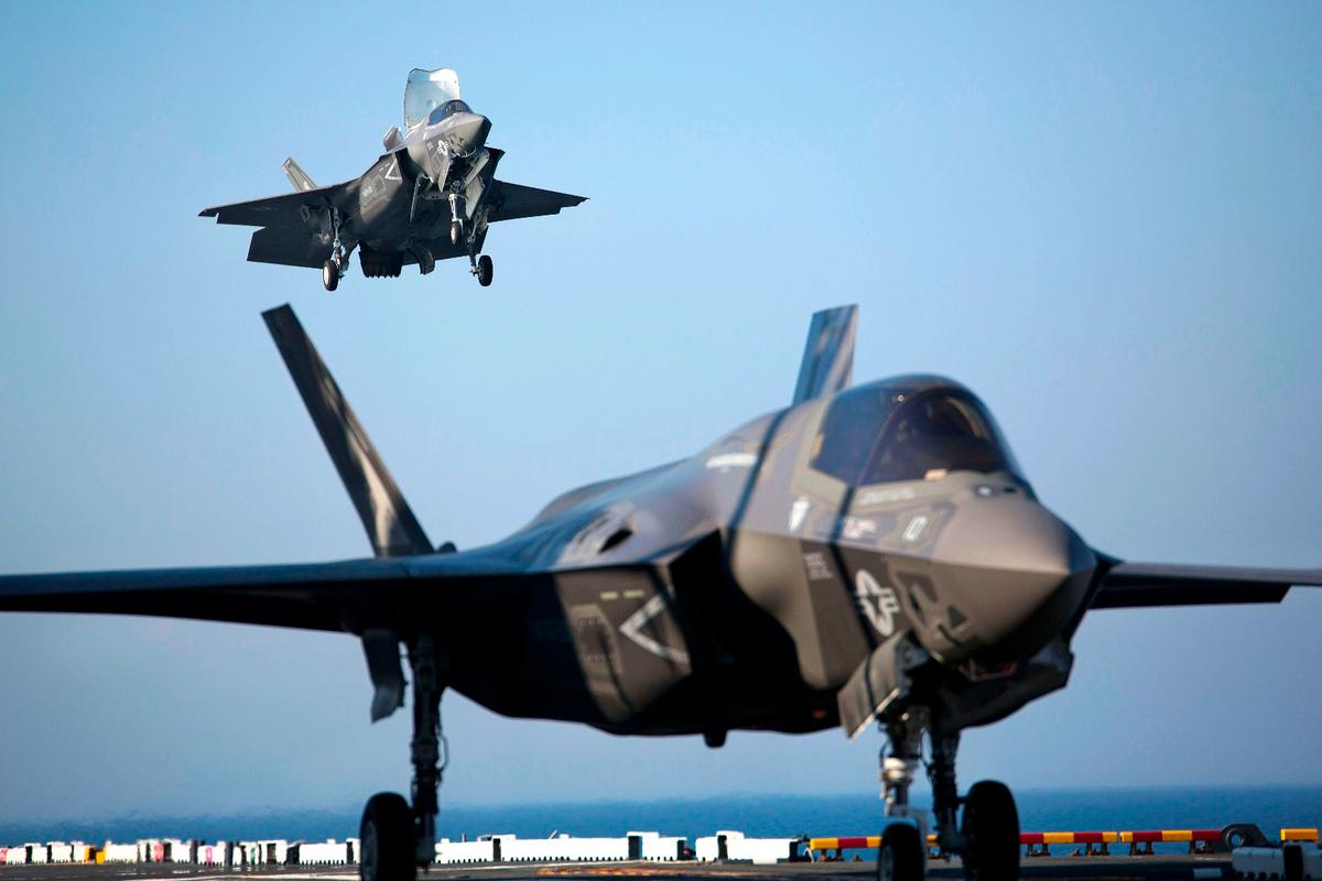 Two F-35B Lightning II Joint Strike Fighters complete vertical landings aboard the USS Wasp (LHD-1) during the opening day of the first session of operational testing