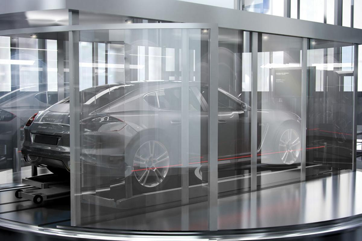 """Glass elevators transport cars to the desired floor and park them in the apartment's """"Sky Garage"""" (Image: Porsche Design)"""