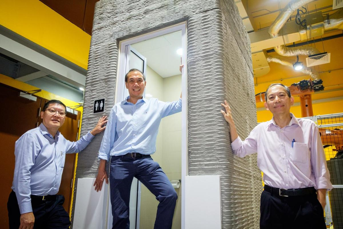(From right) NTU Associate Professor Wong Teck Neng; Lead Scientist and Associate Professor Tan Ming Jen and Er Lie Liong Tjen with their 3D-printed bathroom unit