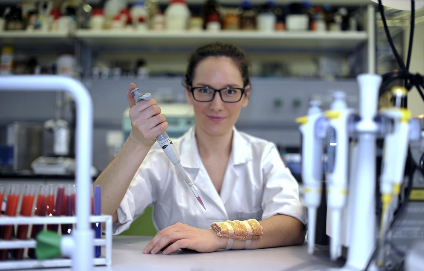 Research team member Dr. Katarzyna Wybranska, with a wound dressing treated with the gold nanocomposite (Photo: ICHF)