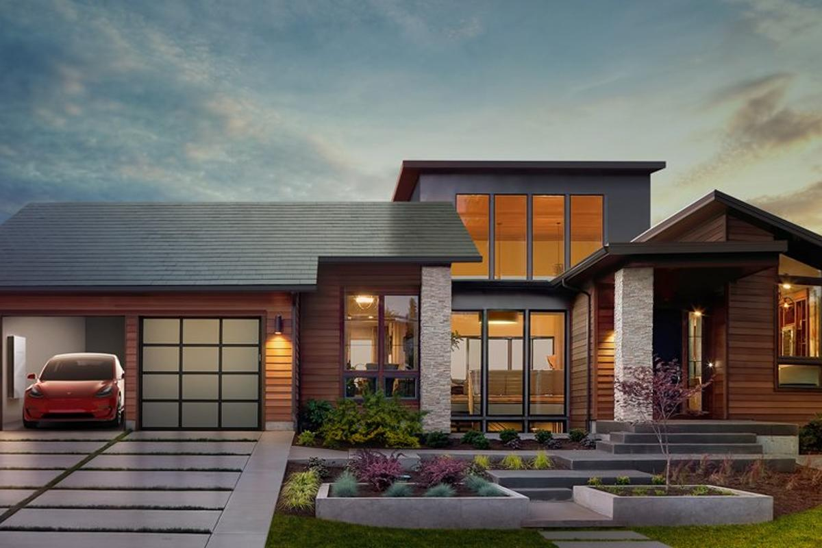 Tesla envisions a house with solar roof tiles and a powerwall and electric vehicle in the garage