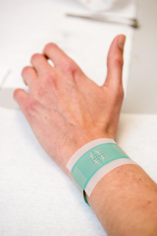 The graphene-based device is worn against the skin without piercing its surface