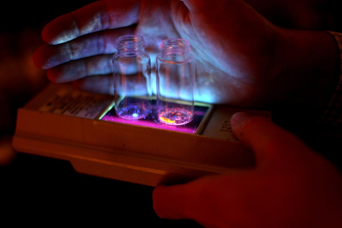 The new phosphors glow in blue and orange when triggered by ultraviolet light (Photo: Marcin Szczepanski, U-M College of Engineering)