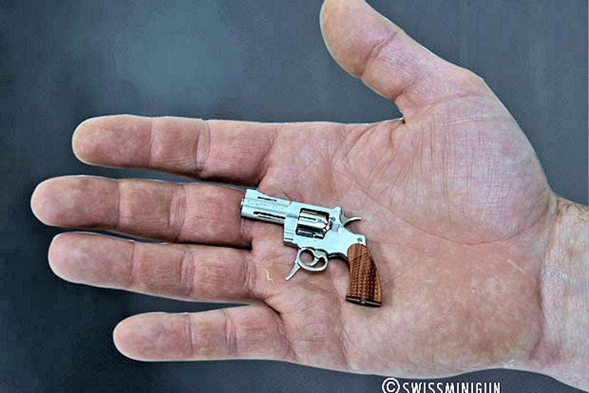 The .09 caliber (2.34 mm) SwissMiniGun is dwarfed in this man's hand (Photo: SwissMiniGun)