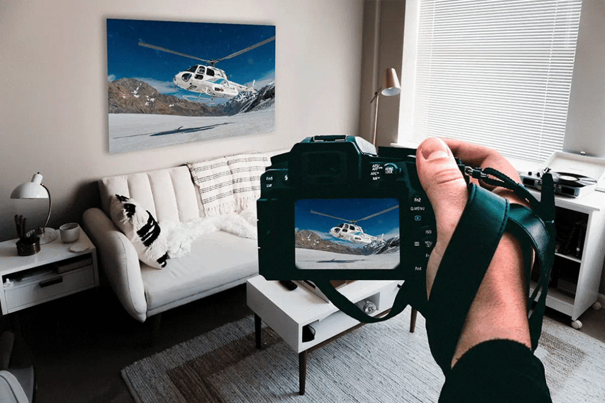 Xpozer's frame holds photos perfectly flat using patented tension-spring technology