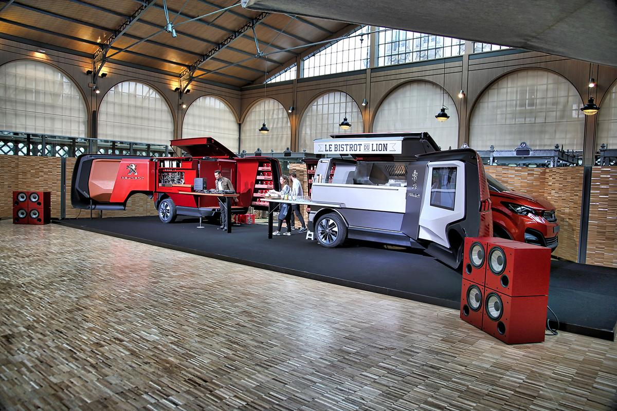 Le Bistrot du Lion transcends the traditional food truck by using a compact van and trailer with massive load capacity which both unfold to double their length and create an entire mobile restaurant catering for 30 patrons. This idea has legs.