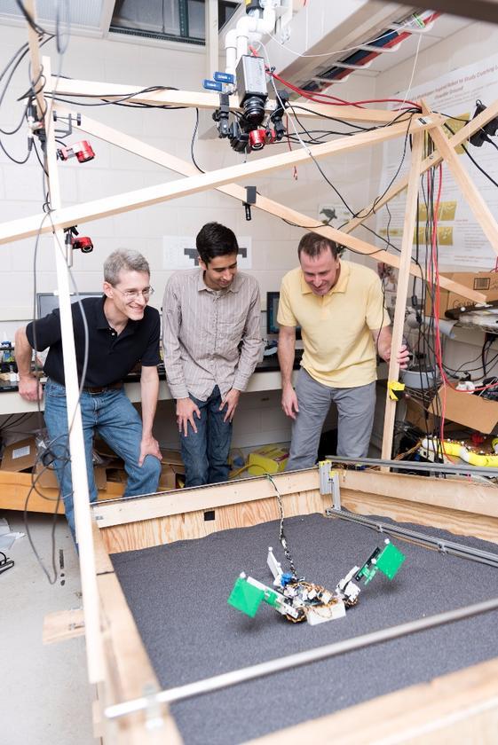Researchers (l-r) Richard Blob, Ben McInroe and Dan Goldmanwatch MuddyBot climb