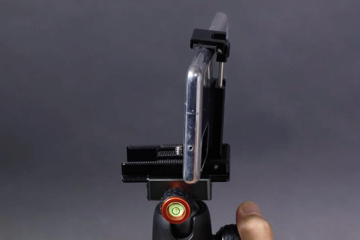 The Smart Plate with its smartphone holder raised, and its camera mounting screw visible to the immeadiate