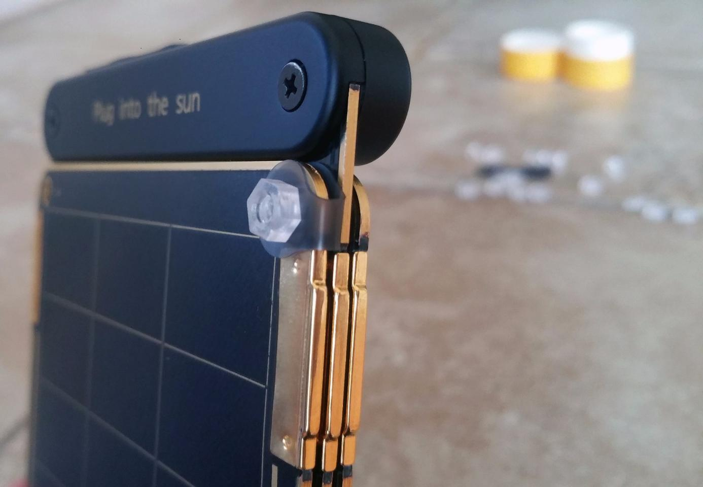 If you're smart about which way to face the includednuts and bolts, Solar Paper's panelswillstill be able to magnetically stack atop each other