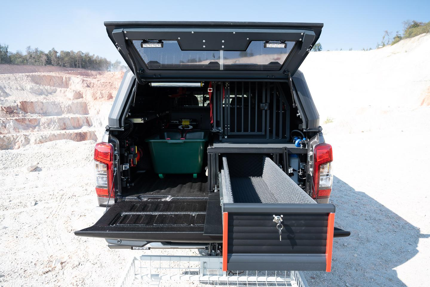 The gun drawer keeps firearms secure, while the dog crate keeps a hunting companion safe and secure