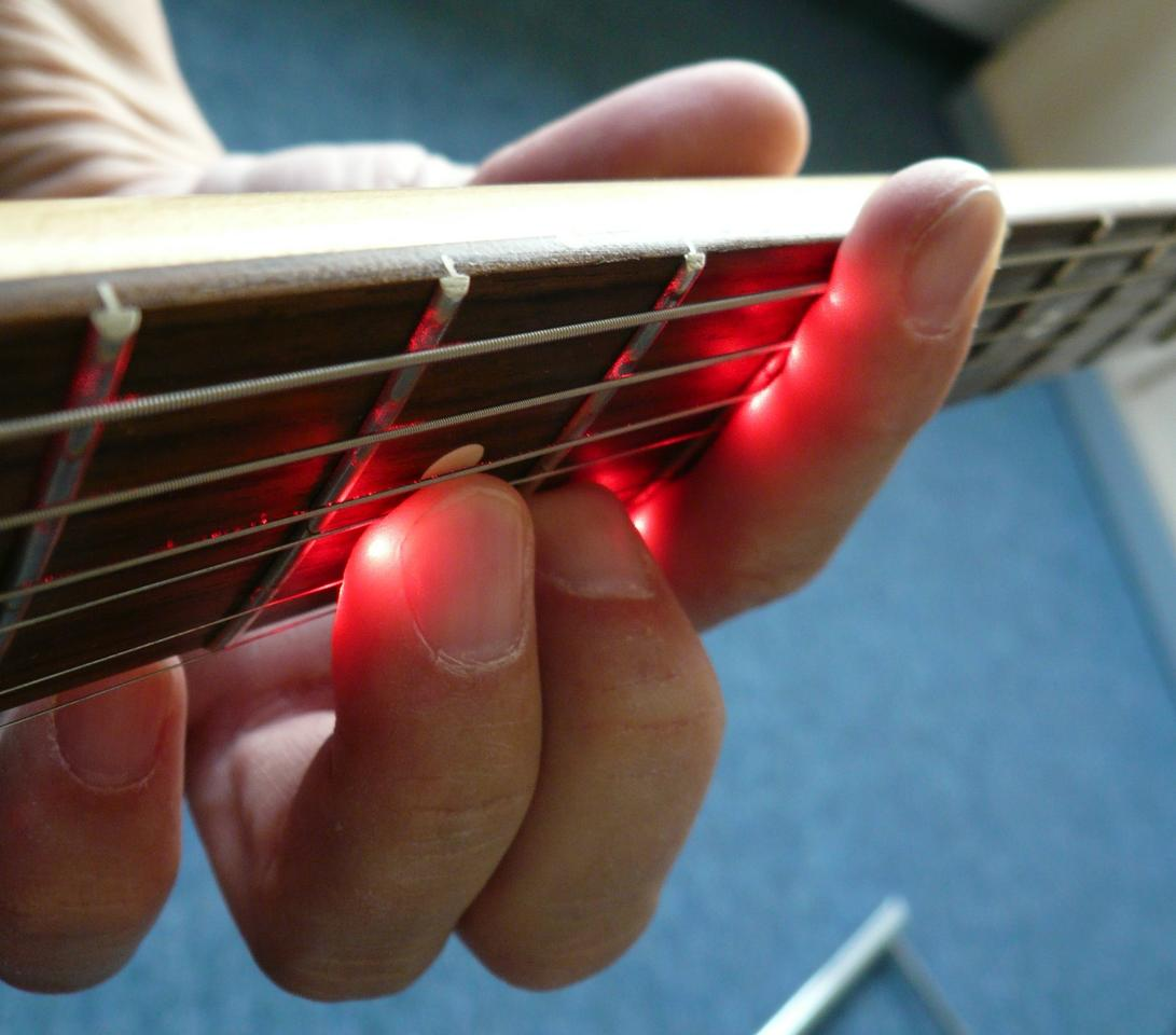 The LPD Pickup system runs a beam under each string, from the bridge to the end of the fingerboard, and monitors its return to photosensitive receptors in the unit