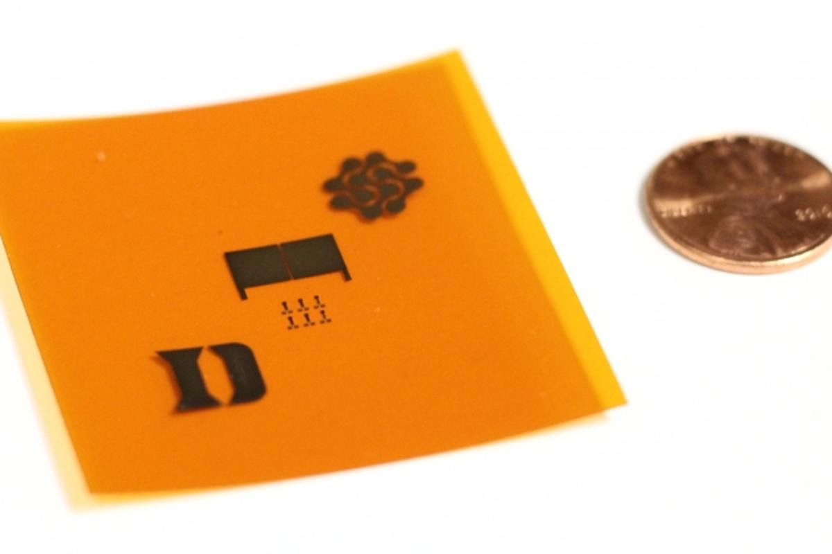 The sensor incorporates two adjacent electrodes, seen here between the logos of Duke University and the Fetch Automotive Design Group