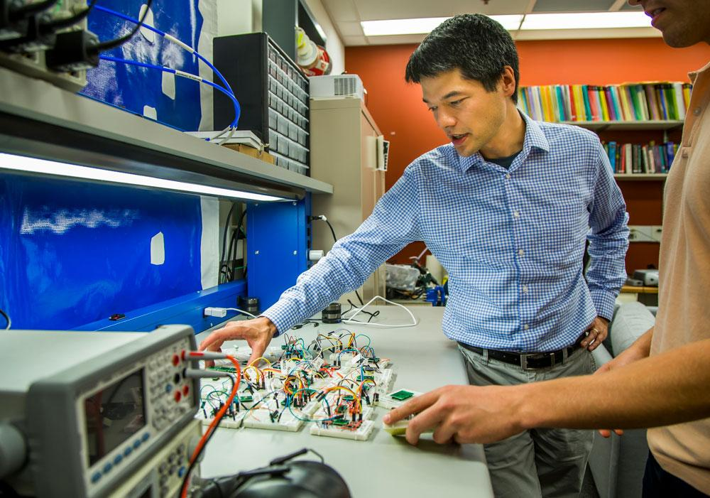 Kevin Fu, associate professor of computer science and engineering, shows how acoustic waves can interfere with the data that certain accelerometer sensors are monitoring